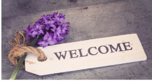 welcome sign with flower for Afghan families